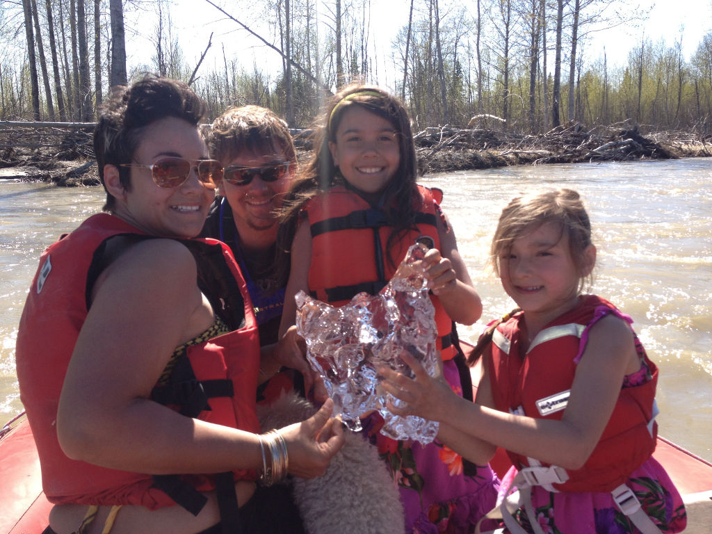 family picking up ice from the Talkeetna river